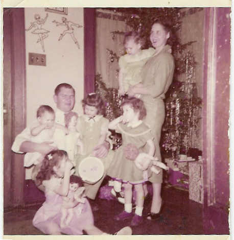 Mary as a child and her family at Christmas